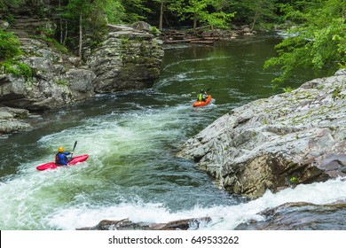 Kayakers enjoy the ride down the river at The Sinks in Smoky Mountains National Park Tennessee