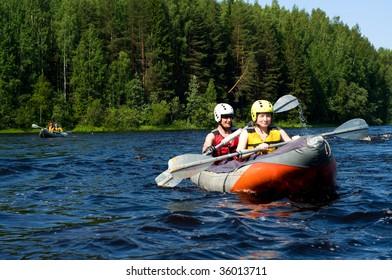 Kayakers sporting a kayak cuts through water