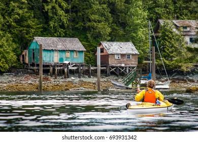 Kayaking among Colorful cabins on Alaskan coast