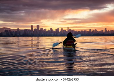Kayaking around Vancouver Downtown, BC, Canada, during a beautiful winter sunrise.