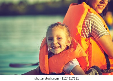 Kayaking and canoeing with family. Children on canoe. Family on kayak ride.