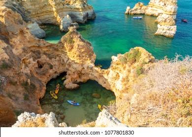 kayaking on Atlantic ocean on Algarve coast in Lagos, Portugal