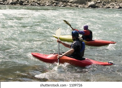 Kayaking on the Bhote Koshi in Nepal. The river has class 4-5 rapids.