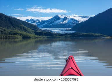 Kayaking on Mendenhall Lake  near Juneau Alaska approaching the glacier on a a sunny summer day.