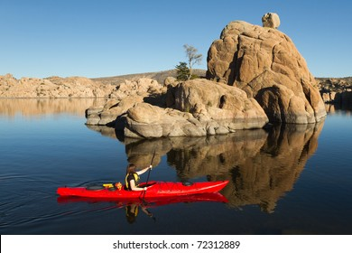 Kayaking on Quiet Lake with Boulders and Rocks