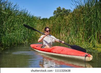 Kayaking on a small water passage. Lake Tisza, Hungary