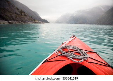 Kayaking through glacial waters near Juneau, Alaska