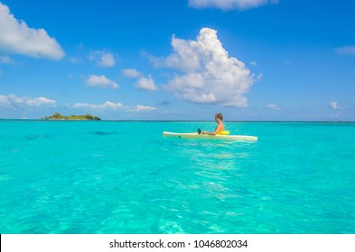 Kayaking in tropical paradise - Canoe floating on transparent turquoise water, caribbean sea, Belize, Cayes islands