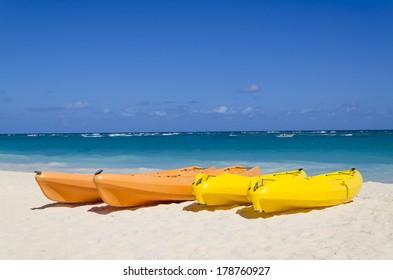 Kayaks on the beautiful sandy Caribbean beach in Dominican Republic