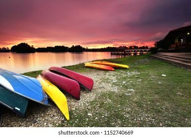Kayaks on the lakeside with beautiful sunset background in Wetland Putrajaya, Malaysia