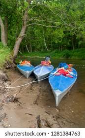kayaks on the riverbank