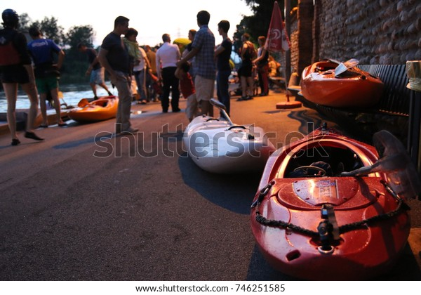 Kayaks on the riverside after a race at sunset. Sport concept, with copyspace.