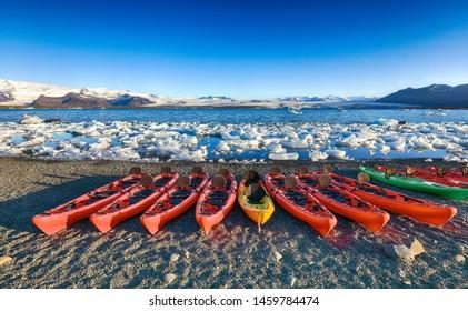 Kayaks on the shore of Jokulsarlon glacier lagoon at sunset. Location: Jokulsarlon glacial lagoon, Vatnajokull National Park, south Iceland, Europe
