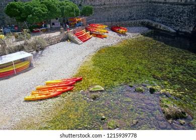 Kayaks in protected harbor under medieval walls  of old city of Dubrovnik, Croatia