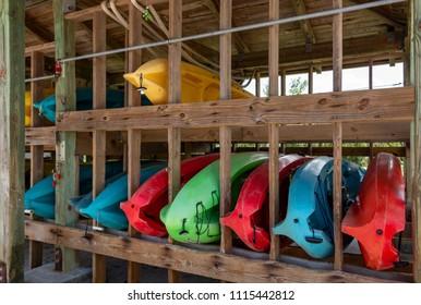 Kayaks for rent on wooden rack at marina - West Lake Park, Hollywood, Florida, USA