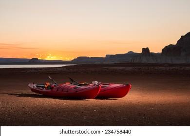 Kayaks Sit on the Receding Shoreline of Lake Powell.
