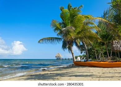 Kayaks sitting on a tropical beach