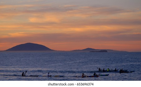 Kayaks at sunset off Mudjimba Island and Mount Coolum, Queensland, Australia