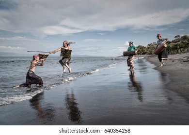 Kayangan beach, East Lombok, Indonesia - April 22, 2017 : Men from the Sasak tribe in Lombok performing a traditional martial art and dance on the beach
