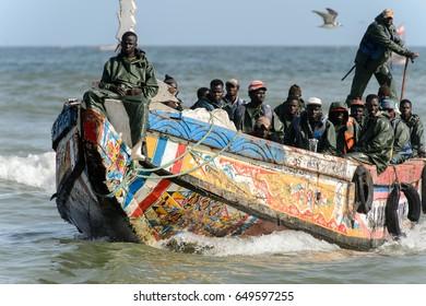 KAYAR, SENEGAL - APR 27, 2017: Unidentified Senegalese people sail on the coast of the Atlantic Ocean. Many Kayar people work in port