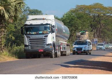 KAYIN STATE, MYANMAR - DECEMBER 28, 2016: Minivan overtaking a tanker truck. Traffic on the highway Bago - Myawaddy