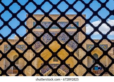 Kaylan mosque thru the lattice with ornaments, Uzbekistan