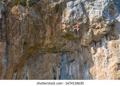 Kaynaklar, Izmir / Turkey - March 14 2020: Rock climber is opening a another climbing path on the rock.