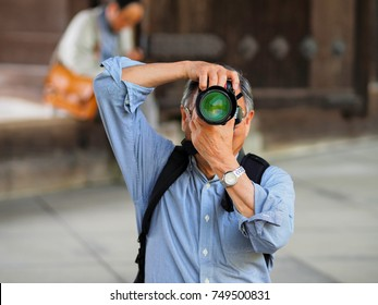 Kayoto, Japan - May 11: Unidentified man makes photo the photographer on May 11, 2014 in Kyoto, Japan