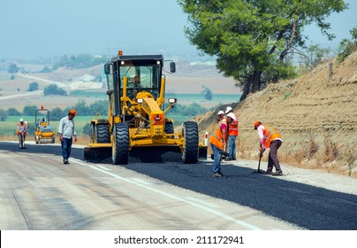 KAYSERI - AUGUST 15: workers repairs road under the program of planned on August 15 2014  in kayseri  Turkey