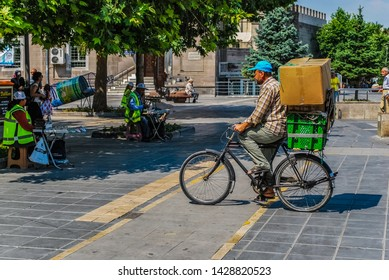 KAYSERI, KAYSERI PROVINCE/TURKEY- AUGUST 11 2015 : View of the streets of Kayseri in Turkey. Kayseri streets with an old man bicycling in Turkey.