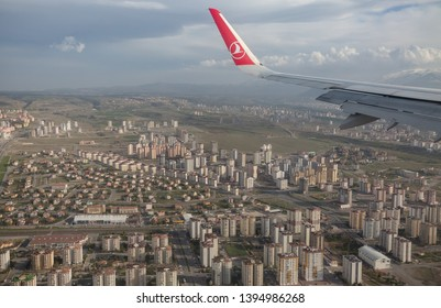 Kayseri, Turkey, May 2019: Turkish airlines flight landing over the high buildings of Kayseri