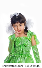 Kazakh girl of 5-6 years in a green dress, full length. Isolation on a white background