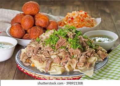 Kazakh national dish of meat and dough - Beshbarmak.