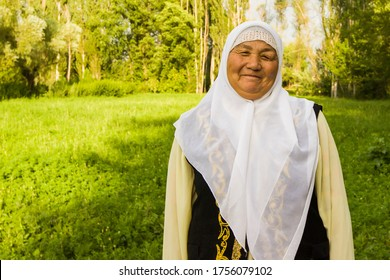 Kazakh old woman in a traditional cloth. Central Asia