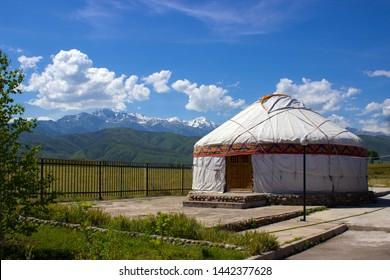Kazakh yurt on a background of mountains