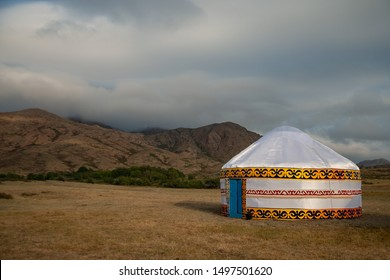 Kazakh yurts in the steppe in the morning on a background of mountains