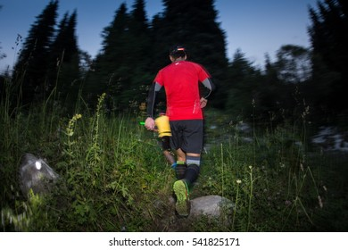 KAZAKHSTAN, ALMATY - 09 JULY 2016: Night trail running competitionsTunRun  that took place in the tract Kok Zhailau. Men and women  on a mountain road  compete with each other.