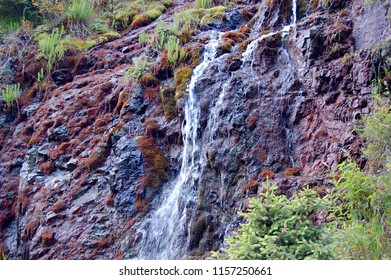 Kazakhstan, Almaty. The tributary of the small Almaatinka River in the vicinity of the city of Almaty, the Mountain River, a stream of clear, transparent water running through the stones forming a sma