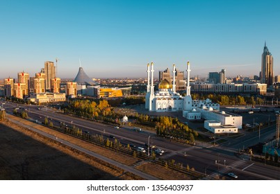KAZAKHSTAN, ASTANA NUR-SULTAN - OCTOBER 04, 2011:  Morning panorama to Mosque Nur-Astana, Khan-Shatyr and residential quarters
