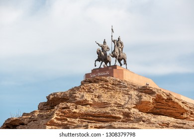 """KAZAKHSTAN, FORT-SHEVCHENKO - FEBRUARY 07, 2019: monument for national heroes Isa and Dosan, who fights for independence Text says: """"Isa - Dosan"""""""