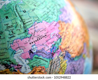 Kazakhstan isolated focus macro shot on globe map for travel blogs, social media, website banners and backgrounds