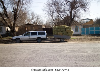 Kazakhstan, Kulan - February 27, 2016: car with a load of hay in the trailer