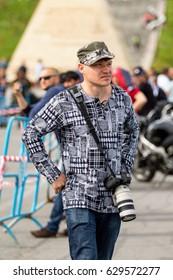 Kazakhstan , Shymkent - April 15, 2017. Men, photographer with camera reporter.