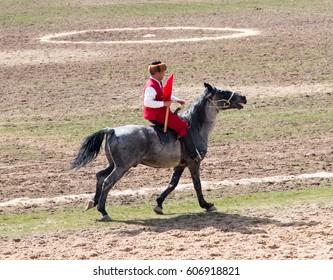 Kazakhstan, Shymkent - March 22, 2017: Kazakh holiday Nauryz. Competitions on the horses.