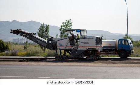Kazakhstan, Ust-Kamenogorsk – 18 July, 2019. Cold milling machines Wirtgen. Pavement milling. Road construction on main street.