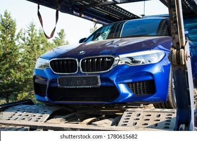 Kazakhstan, Ust-Kamenogorsk – 26 June, 2020, Car BMW F90 M5 on a car carrier trailer