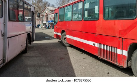 Kazakhstan, Ust-Kamenogorsk, april 21, 2018: City buses at the bus stop. Buses on parking. Buses at the bus terminal