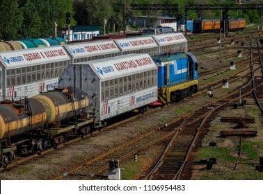Kazakhstan, Ust-Kamenogorsk, june 1, 2018: Shunter or Switcher. Locomotive with wagons at the railway station. Freight trains and wagons