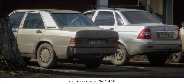 Kazakhstan, Ust-Kamenogorsk, march 29, 2019: Mercedes-Benz 190 (W201) and Lada Priora