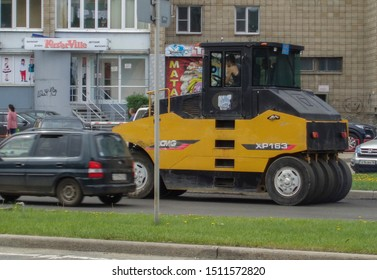 Kazakhstan, Ust-Kamenogorsk, may 22, 2019: Steamroller. Equipment for construction and repair roads. Yellow steamroller on the street